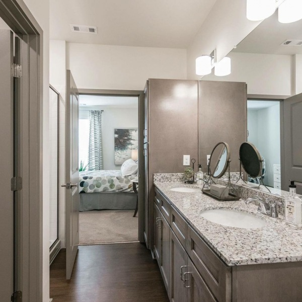 How gorgeous is this bathroom?! This is The Cumberland, our biggest two bedroom. Featuring double vanity, huge walk-in closet, a deep garden tub AND a stand up shower!